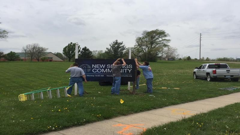 Putting up the new NSC sign